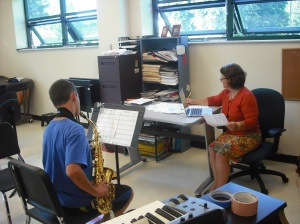 A student saxaphone player auditions for Symphonic Band.