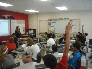 Students in one of Ms. D'Archangelo's English classes scramble to answer questions.