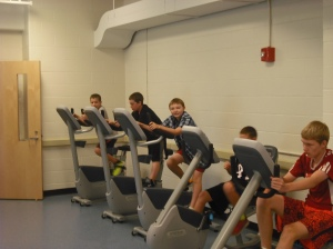 The boys from 7B test ride the new exercise bikes.