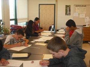 Ms. Baldwin assists students with a perspective drawing assignment.