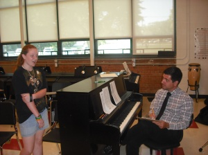 Andrew Mullen listens to a student audition for Select Chorus.