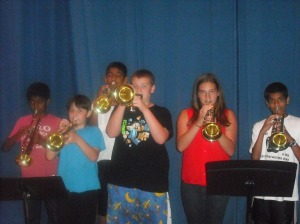 A group of student trumpet players warm up for their auditions.
