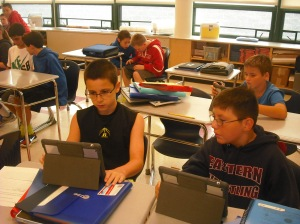 Students collaborate on a group project using their iPads.
