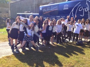 The MSMS select choir pose for a photo alongside the John Lennon Education Tour Bus.