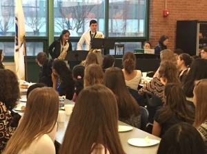 A trio of 8th grade scholar-musicians perform for their classmates during the Scholar's Brunch.