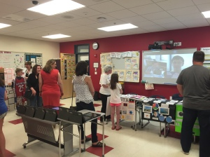 6B Socail Studeis teacher, Mrs. Sturtevant, displays student projects on desks and through the projector/