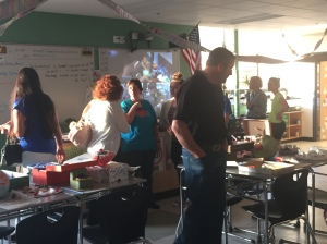 Parents and Students check out student Science Projects in Mrs. Pratt's room.