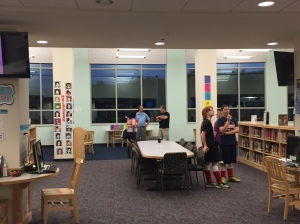 Students and their Parents explore the Media Center.