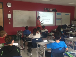Ms. Arrington goes over her class' do-now activity at the beginning of class.
