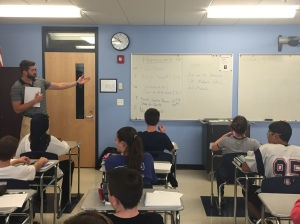 Mr. Nelson points out the warm-up question on the whiteboard.