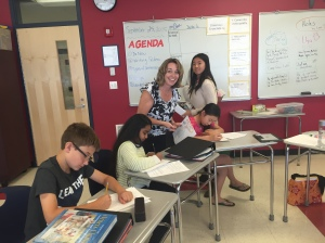 Mrs. Gover assists students during a 6C reading block.
