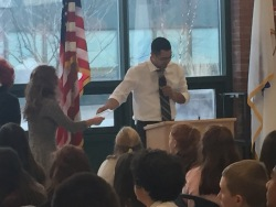 8B Science teacher hands out awards to scholars from his homeroom.